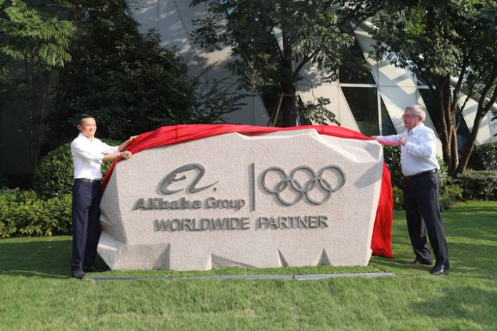 Alibaba founder Jack Ma (left) with former IOC chief Thomas Bach (right) - InsideSport